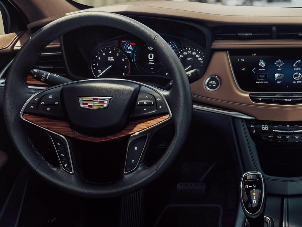 A Cadillac dashboard. A Diminished Value Appraiser in Miami, Florida call 772-359-4300.